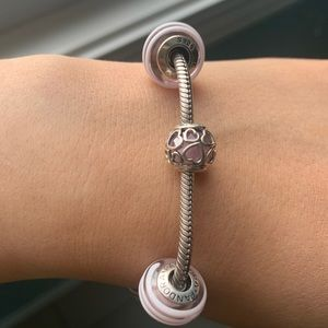 Pandora bracelet with 3 charms & stopper